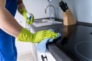 house cleaner wiping kitchen top